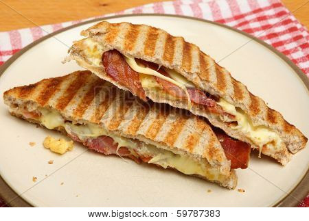 Toasted sandwich with bacon, egg and cheese.