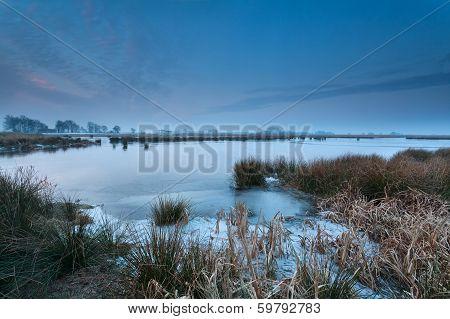 Frozen Wild Lake In Winter