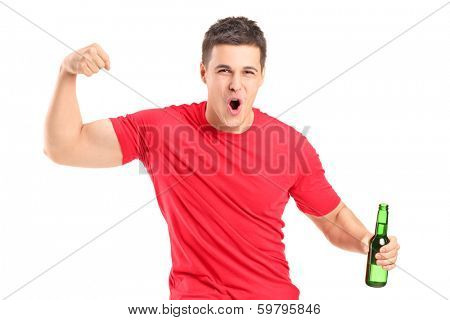 Euphoric fan holding a beer bottle and cheering isolated on white background