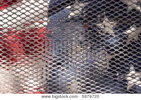 American Flag behind bars
