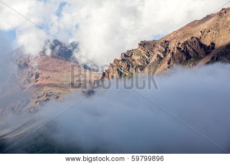 Rocks covered by clouds. Tien Shan