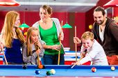 picture of pool ball  - Family playing together billiard with queue and balls on pool table  - JPG