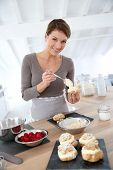 image of cream puff  - Woman in kitchen preparing cream puffs - JPG