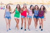 foto of spring break  - group of teens in spring break vacation - JPG