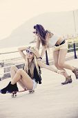 pic of skateboarding  - teens having fun with skateboard - JPG