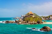 stock photo of shacks  - Turquoise water and beach shack at Cabo San Juan del Guia in Tayrona National Park in Colombia - JPG