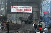 KIEV, UKRAINE - FEB 10, 2014: Burned downtown of Kiev with poster - Poland agree with protesters ( U