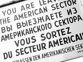 foto of cold-war  - The famous sign at Cold War era Checkpoint Charlie in Berlin, Germany.