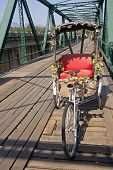 stock photo of tricycle  - Tricycle on old bridge  - JPG