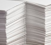stock photo of collate  - Stacks of paper that have been collated - JPG