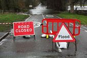 stock photo of sandbag  - Road closed and flood sign due to heavy rain and floods - JPG