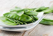 picture of snow peas  - Snow Peas on a wooden table  - JPG