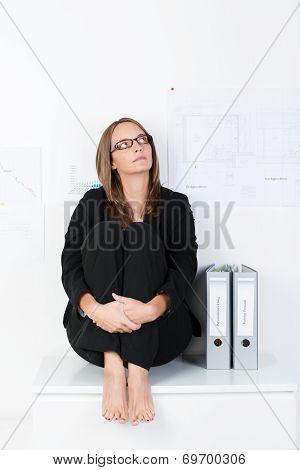 Barefoot Businesswoman Sitting Thinking