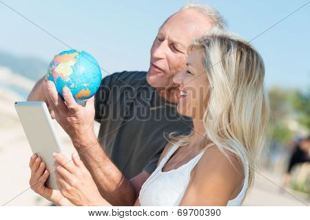 Happy Couple Deciding On Their Next Vacation