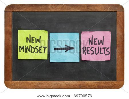 new mindset and new results  concept - colorful sticky notes on a vintage slate blackboard  isolated on white