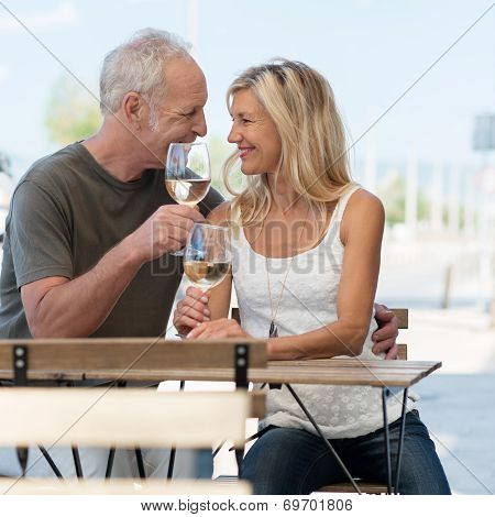 Romantic Couple Enjoying A Glass Of White Wine