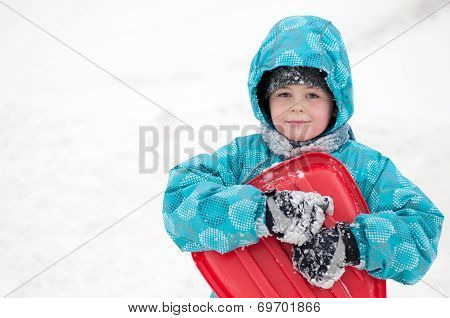 Boy With Sleds On The Hill