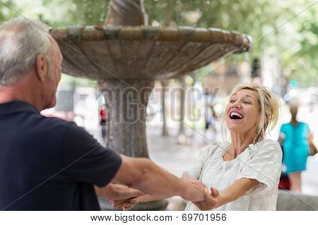 Middle-aged Woman Laughing With Enjoyment