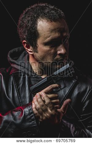 rob, thief with gun in hand. man in leather jacket
