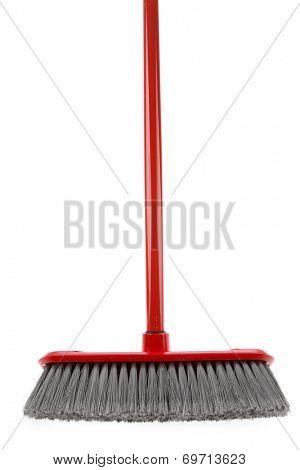 Closeup of broom on white