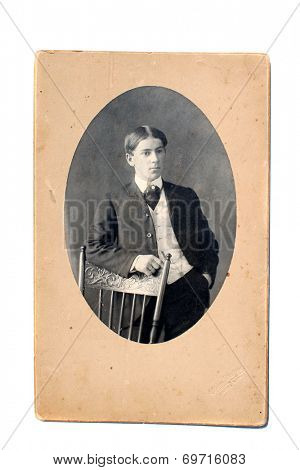 USA- CIRCA 1900s: An antique photo shows studio portrait of a young man.