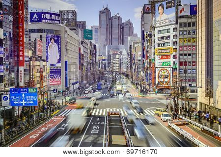TOKYO, JAPAN - MARCH 18, 2014: Traffic at Shinjuku district. Shinjuku is the commercial and administrative center of the city.