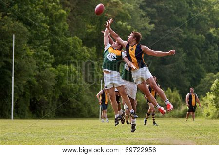 Players Jump For Ball In Australian Rules Football Game