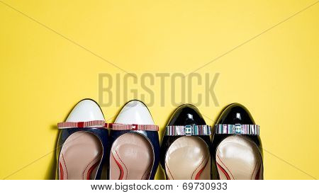 Woman Shoes On Yellow Background