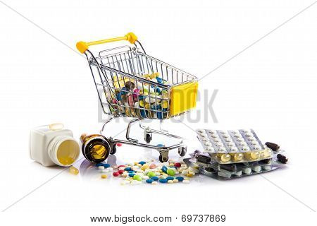 Colorful Tablets In The Cart.  Shopping Cart With Medicine Pills On A White Background