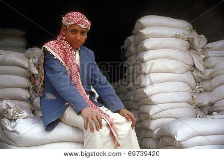 Boy At Flour Factory