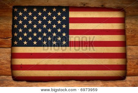 Old Usa Flag On Antique Wood Backdrop