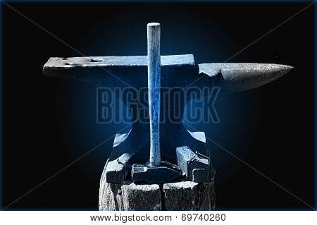Hammer And Anvil On Blue
