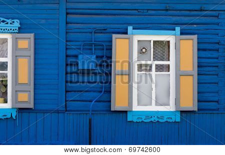 Wooden window with shutter doors.