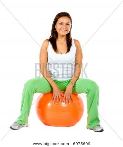 Woman Sitting On A Pilates Ball