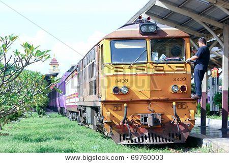 Train driver clean window of Alsthom Diesel locomotive