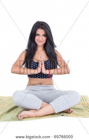 Young girl sitting with crossed legs excercising