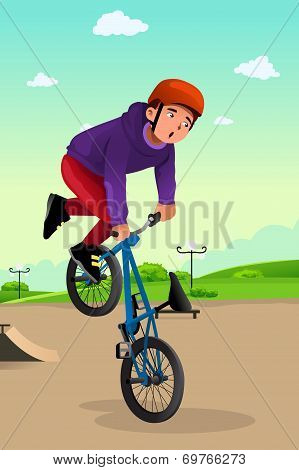 Boy Doing A Bike Stunt
