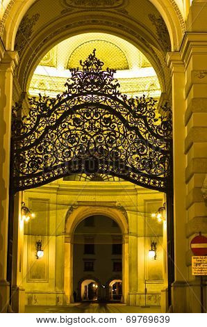 Gate and entrance to Hofburg palace at night, Vienna