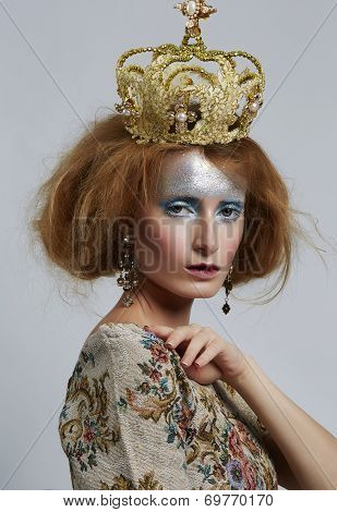 Fashion Model With Crown Red Wavy Hair And Make-up Style