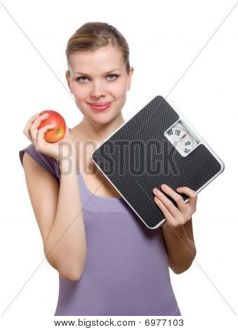 Smiling Young Woman Holding A Weight Scale And Red Apple