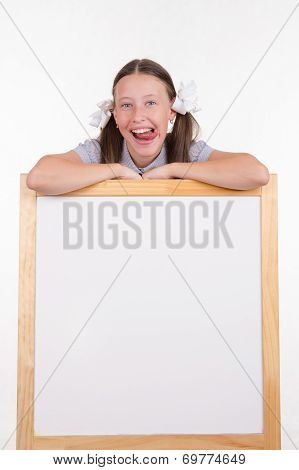 Girl Shows Tongue Advertising Stand
