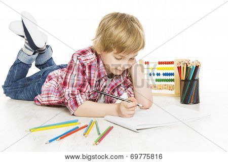 School Boy Writing Exercise In Notebook. Schoolboy Do A Sum Of Mathematics Homework, Isolated On Whi