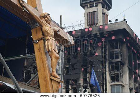 KIEV, UKRAINE - APR 7, 2014: Second crucifixion of Jesus.Burned downtown of Kiev.Rioters camp. Riot in Kiev and Western Ukraine.April 7, 2014 Kiev, Ukraine