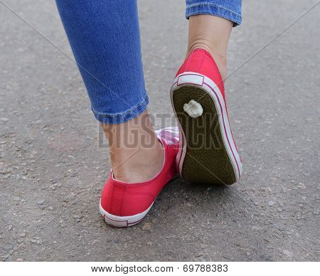Foot stuck into chewing gum on street