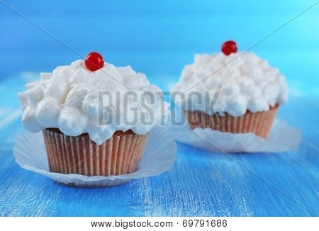 Tasty cupcake on table, close up