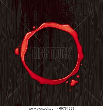 Bloody round frame on black wood texture background