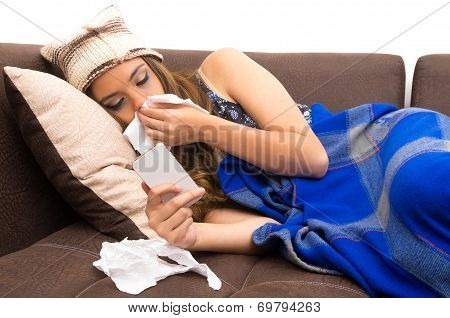 Beautiful young sick girl with a cold