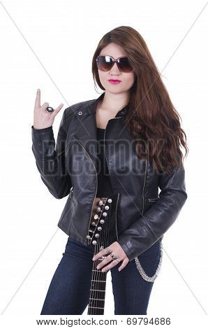 Beautiful  young rocker girl wearing leather jacket and posing