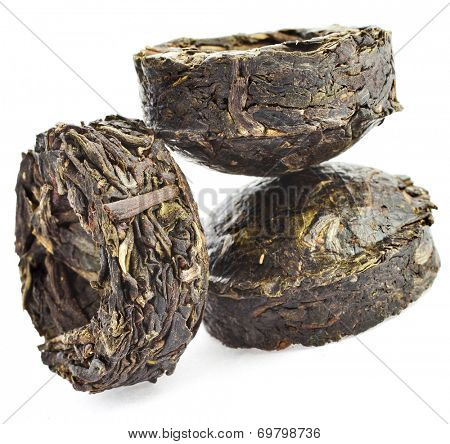 Press Green Tea Puer (Yunnan Puer Sheng Tuo) isolated on white background