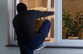stock photo of bandit  - Horizontal view of burglary into the house - JPG